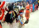 A young boy keeps dancing during speeches at an All Nations Powwow, Saturday afternoon at Brandon University. The celebration started in 2010 and honours indigenous, Métis and Inuit graduates, with approximately 30 of the dancers being new diploma holders.