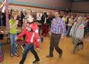 Olympic gymnast Isabela Onyshko, followed by father Dan and coach Lorie Henderson, arrives to an enthusiastic crowd at the Minnedosa Community Conference Centre on Thursday evening.