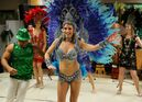 Jennifer Barr and other members of Brandon's Capoeira Guanabara      club dance the Samba in colourful costumes during a Brazilian Carnival at the Prairie Oasis Seniors Centre on Eighth Street on Saturday evening. The event included food, dancing and performances by Capoeira Guanabara.