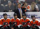 Philadelphia Flyers head coach Dave Hakstol looks on from the bench against the New York Islanders during the third period of an NHL preseason hockey game in Allentown, Pa., Monday, Sept. 21, 2015. Hakstol is confident he can make the leap from college coaching to the NHL's Flyers. THE CANADIAN PRESS/AP/Rich Schultz
