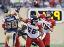 Calgary Stampeders quarterback Bo Levi Mitchell (19) throws against the Winnipeg Blue Bombers during the second half of CFL action in Winnipeg Saturday, August 29, 2015. THE CANADIAN PRESS/John Woods