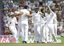 England's James Anderson, third left, celebrates with his teammates after catching out India's Bhuvneshwar Kumar off a Moeen Ali, second right, delivery during the fifth and final day of the third cricket test match of the series between England and India at The Ageas Bowl in Southampton, England, Thursday, July 31, 2014. (AP Photo/Matt Dunham)