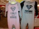Pajamas for three-month-old girls and boys are seen at a Target store in Waterloo, Ont., on Sunday Sept. 28, 2014. The photograph has sparked a social media debate about gender stereotyping of babies. THE CANADIAN PRESS/HO-Christine Logel