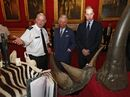 Britain's Prince Charles, center, and his son Prince William are shown items made from endangered animals, which had been confiscated by customs officers, during a conference on the illegal wildlife trade, at Clarence House, London, Tuesday May 21, 2013. (AP Photo/Andrew Winning, Pool)