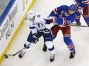 Tampa Bay Lightning defenseman Anton Stralman (6) seals off New York Rangers defenseman Ryan McDonagh (27) from the puck during the second period of Game 7 of the Eastern Conference final during the NHL hockey Stanley Cup playoffs, Friday, May 29, 2015, in New York. (AP Photo/Julie Jacobson)