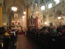 In this photo taken on Oct. 12, 2014, Detroit Archbishop Allen Vigneron delivers his homily during Mass at St. Francis D'Assisi Church in Detroit. Building on the idea of flash mobs, a group called the Detroit Mass Mob picks one historic Roman Catholic church per month and encourages area worshippers to show up for a service. Its church for October was St. Francis D'Assisi. (AP Photo/Mike Householder)