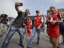 Ferrari driver Sebastian Vettel of Germany walks in the paddock at the Monza racetrack, in Monza, Italy , Thursday, Sept. 3 , 2015. The Formula one race will be held on Sunday. (AP Photo/Antonio Calanni)