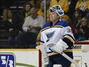 In this Dec. 4, 2014, file photo, St. Louis Blues goalie Martin Brodeur looks up at the scoreboard during a timeout in the first period of an NHL hockey game against the Nashville Predators in Nashville, Tenn. Brodeur, one of the greatest goaltenders in NHL history, is retiring. He starred for years with New Jersey Devils and is now with St. Louis. (AP Photo/Mark Zaleski, File)