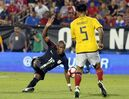 U.S. midfielder Nagbe Darlington takes a shot and scores in front of Ecuador's Christian Ramirez (5) during the second half of an exhibition soccer match, Wednesday, May 25, 2016, in Frisco, Texas. The United States won 1-0. (AP Photo/Tony Gutierrez)