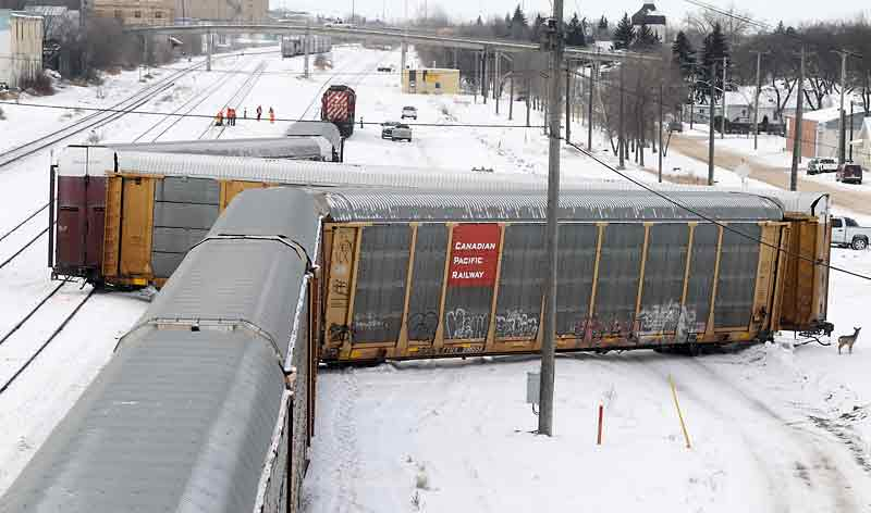 Three rail cars jumped the tracks in the Canadian Pacific Railway yards between the First Street overpass and the Eighth Street bridge on New Year's Day.  BRUCE BUMSTEAD/BRANDON SUN