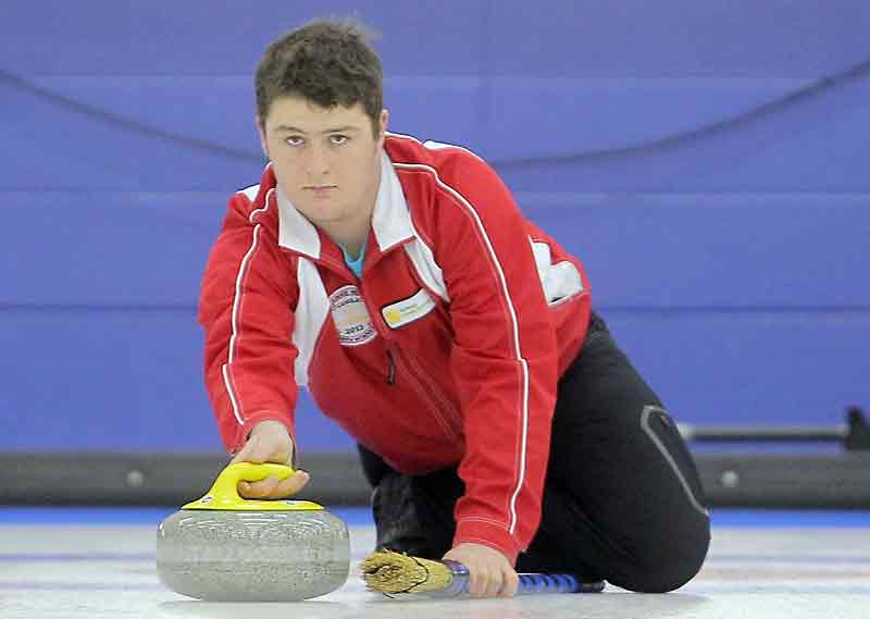 Carberry's Austin Mustard delivers a shot during the junior men's provincials.
