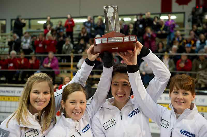 Skip Jennifer Jones, third Kaitlyn Lawes, second Jill Officer, and lead Dawn Askin celebrate after defeating Barb Spencer 9-3 in the final of the provincial Scotties Tournament of Hearts in Stonewall on Sunday.