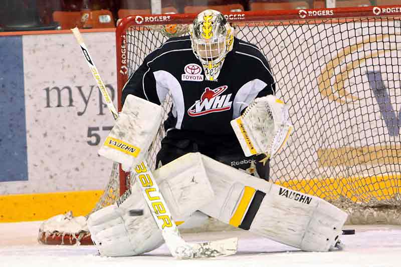 Wheat Kings netminder Corbin Boes stops a shot Wednesday in his first full practice since suffering a knee injury.