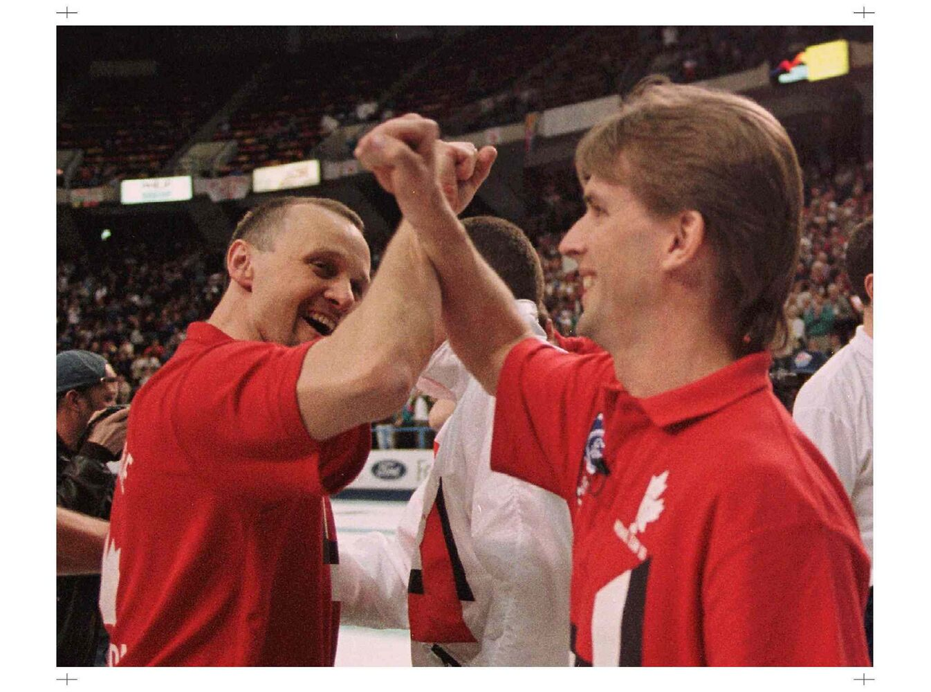 Team Canada skip Jeff Stoughton (right) celebrates with teammate Garry Vandenberghe after Canada defeated Scotland to win the 1996 World Curling Championships in Hamilton. (Moe Doiron / The Canadian Press Files)