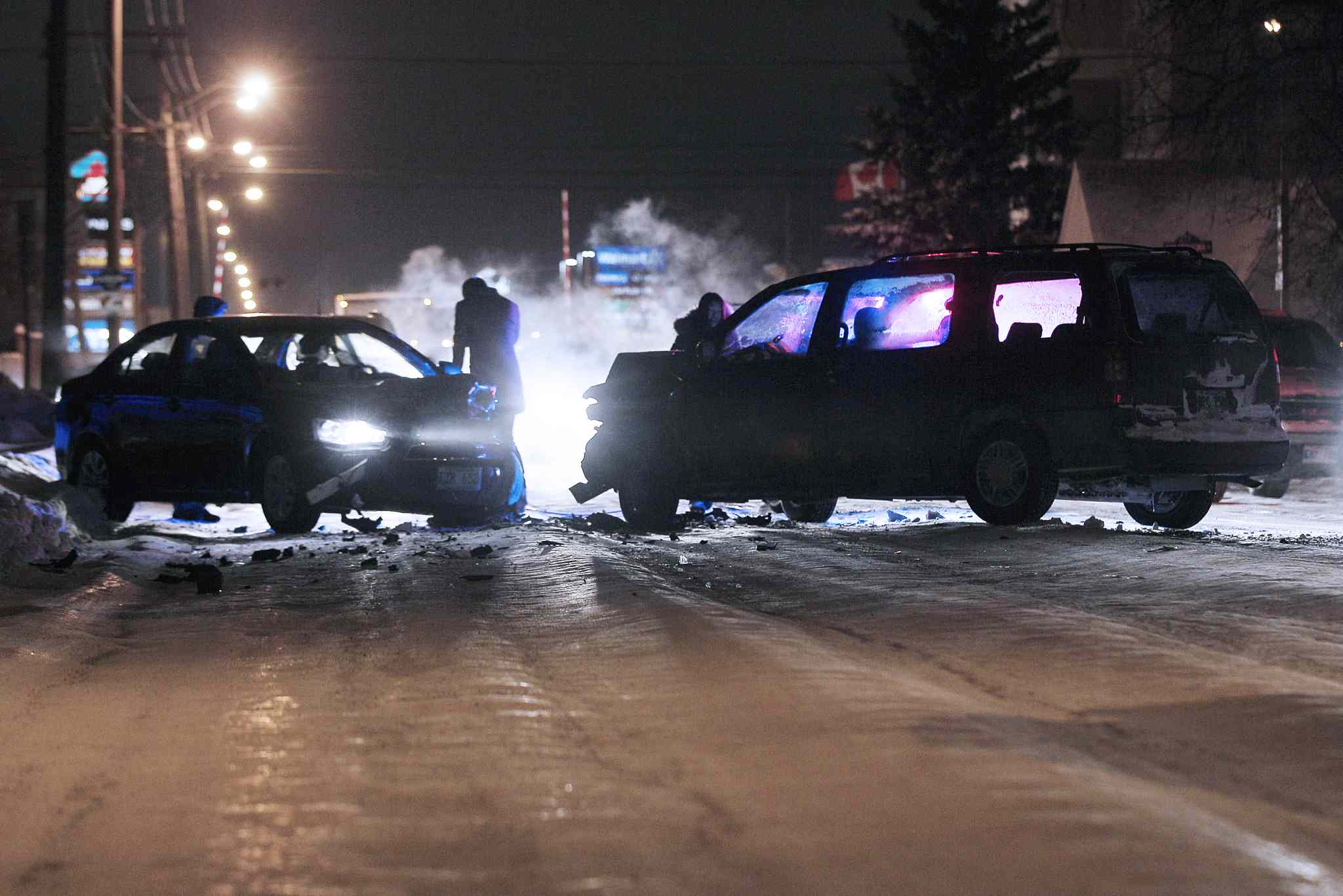 The aftermath of a collision on Ellice Avenue after vehicles slid on the icy, rut-filled road Monday evening. Fender-benders have been commonplace.