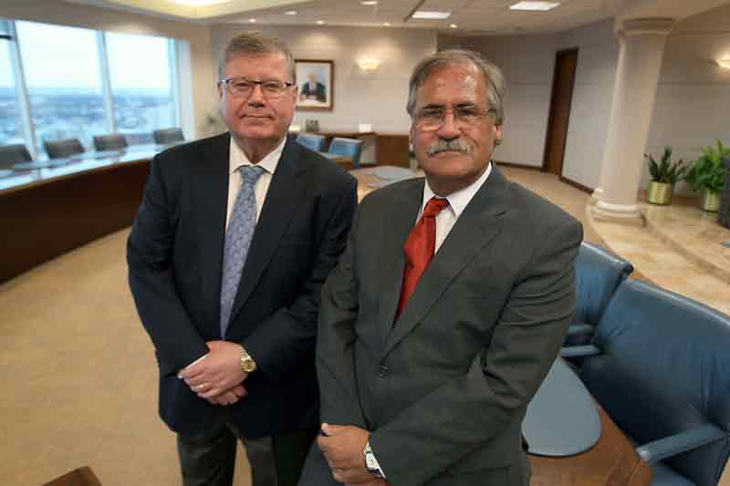 Don Douglas, left, managing partner of Winnipeg law firm Thompson Dorfman Sweatman, and Paul Roy, managing partner of Roy Johnston in Brandon. The two firms have merged as part of TDS' strategy to expand outside of the Perimeter Highway. The Brandon office will be known as Roy Johnston/TDS.