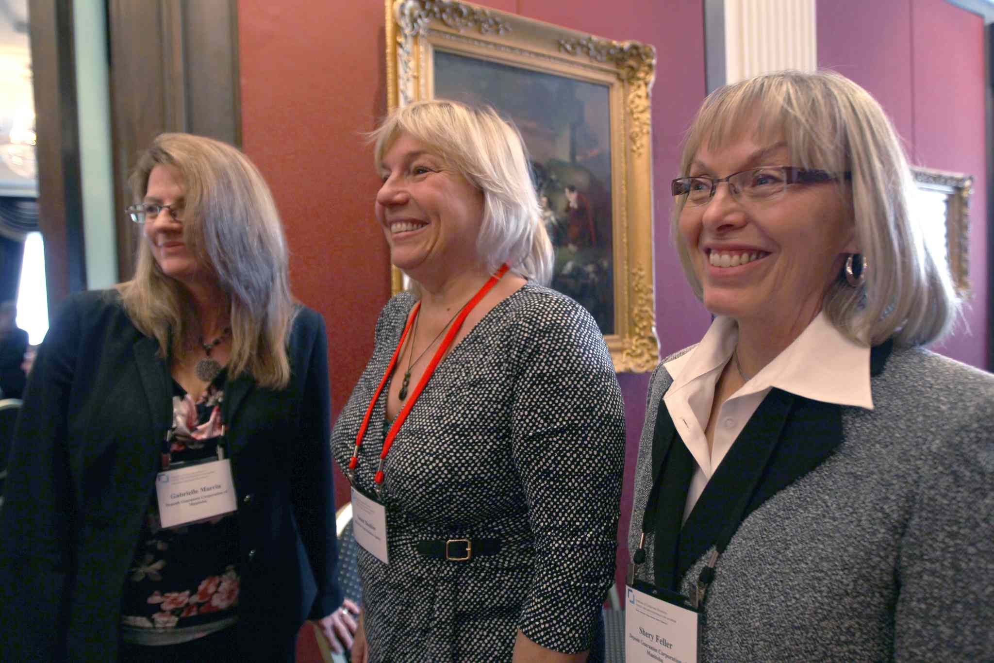 Gabrielle Marrin, left, and Shery Feller, right, of the Deposit Guarantee Corporation of Manitoba are joined by Susan Boulter, director of Manitoba Vital Statistics Agency, at a luncheon Wednesday.