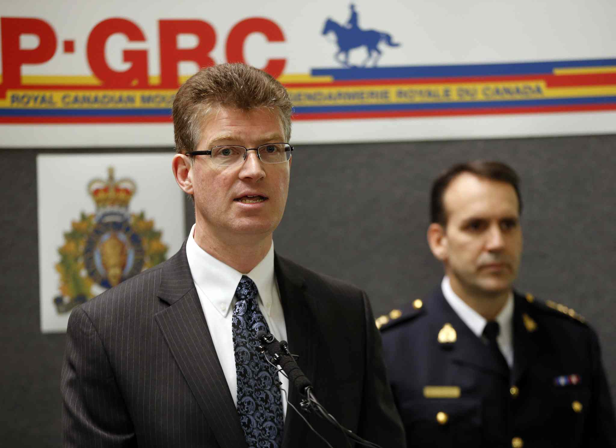 """For the first time in North America, The Hells  Angels Motorcycle Club  has been listed as a criminal organization eliminating days of court time normally used to establish this designation. Justice Minister Andrew Swan (left) with Assistant Commissioner Kevin Brosseau, commanding officer, RCMP """"D"""" Division at the press conference."""
