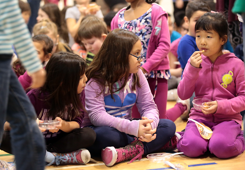 Students at King George School enjoy a healthy protein snack, supplied by Maple Leaf Foods, following Monday's funding announcement for the Food for Thought program.