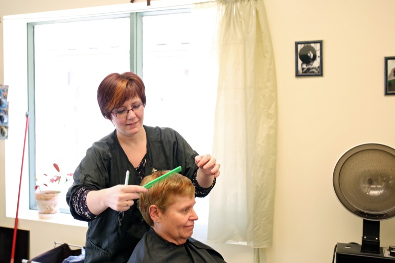Tanya Teetaert with Tanya's Beehive Lounge styles the hair of Wendy Whitlaw at the salon on Park Avenue at 13th Street on Friday afternoon. Teetaert is interested in looking into the details of the new liquor laws that allow the serving of alcohol in salons.