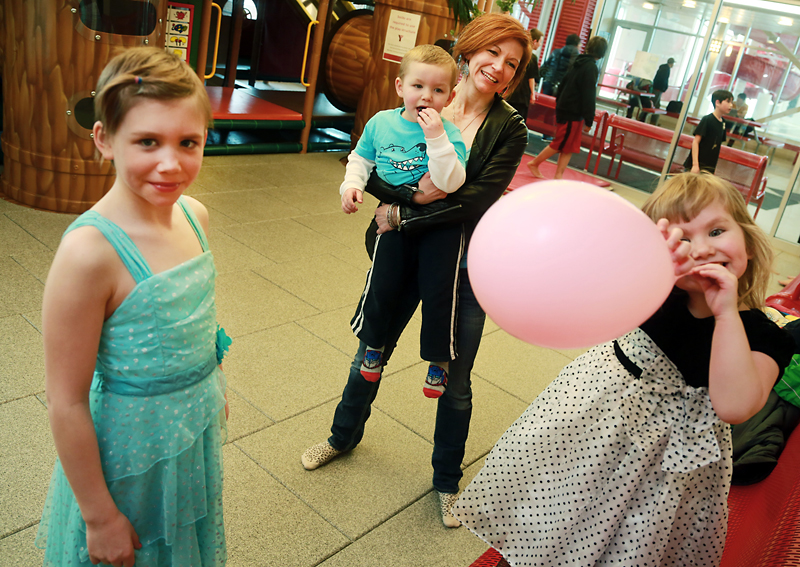 Christina Haskey holds son Lyndon Jr. as daughters Denyka, left, and Aspen play at the downtown YMCA on Sunday afternoon. Haskey and her children stayed at the YWCA Westman Women's Shelter last March. During their 21-day stay, the YMCA provided her and her children with passes to the Y's facility and the YMCA Strong Kids Campaign sent Denyka to a day camp for free.