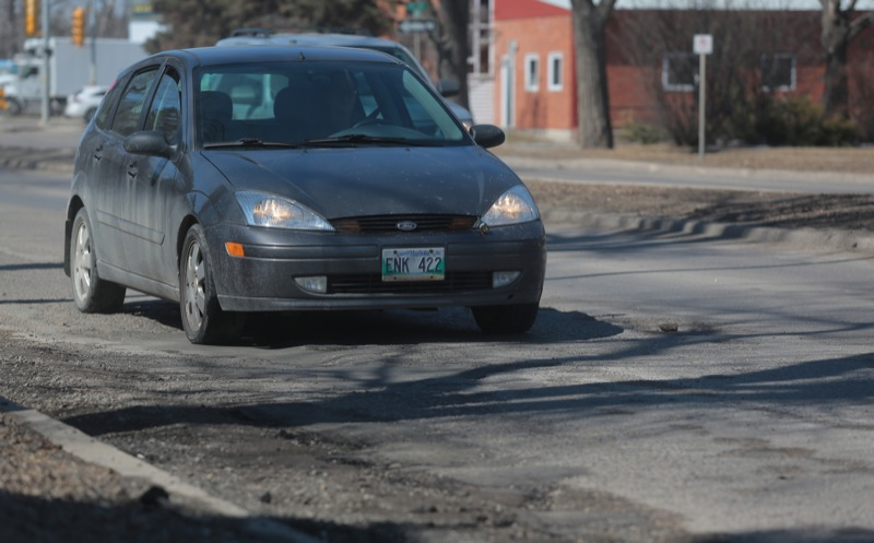 Traffic travels along a rough section of Victoria Avenue, which currently is ranked in the top ten worst roads, on Thursday afternoon. (Bruce Bumstead/Brandon Sun)