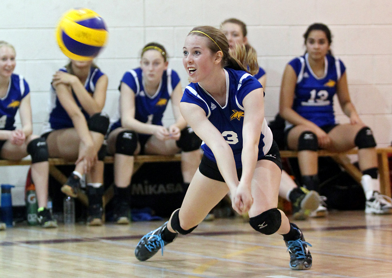 Kenzie Robinson of the Cats Gold dives for the ball during the 16U girls' club volleyball provincial championship at Crocus Plains Regional Secondary School on Saturday afternoon.