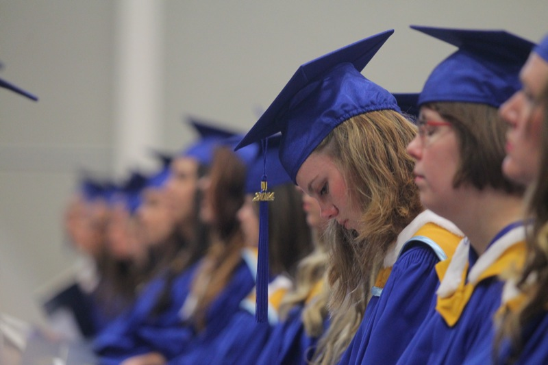 A Brandon University graduate waits to receive her diploma at Friday's convocation ceremony.