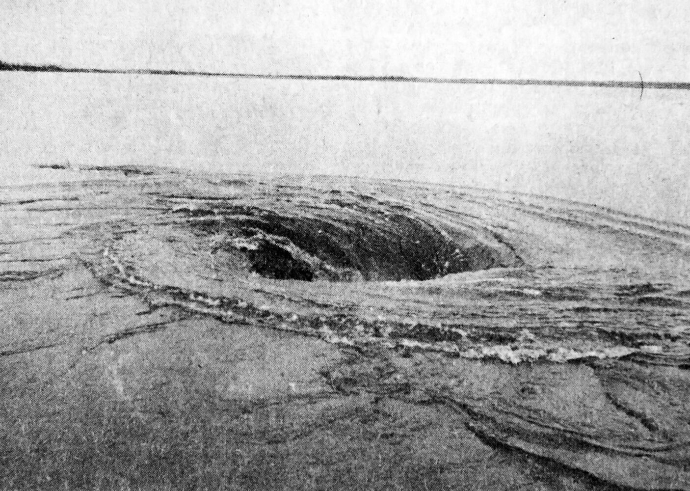 Water being sucked into a culvert forms a large whirlpool one mile west of Souris at Highway 2. (Brandon Sun archives, April 22, 1976)