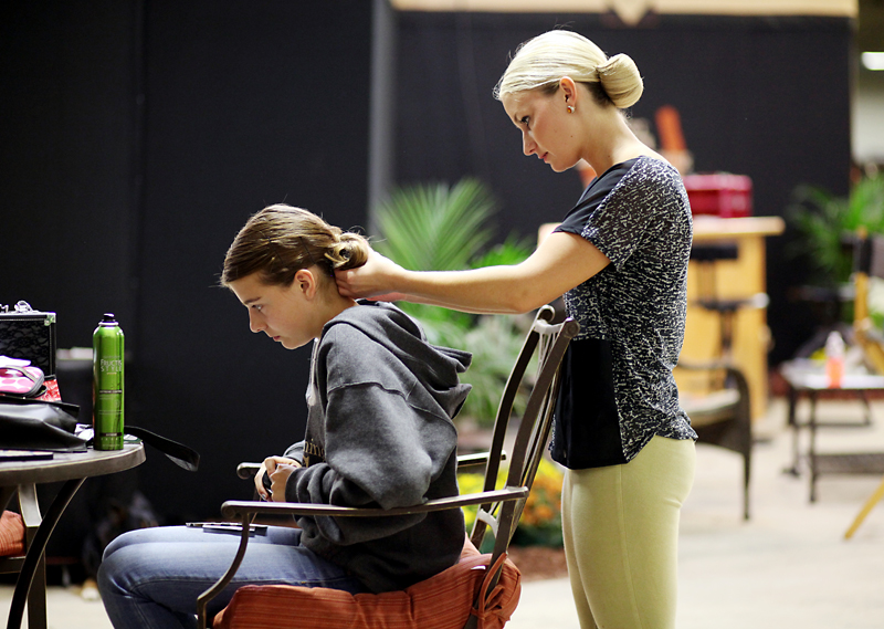 Emmy Farago has her hair done by Cassie LeFever prior to showing in the western horsemanship category on behalf of LeFever Training Centre in Hudson, Wis., during the first day of the Canadian National Arabian & Half-Arabian Championship Horse Show at the Keystone Centre.