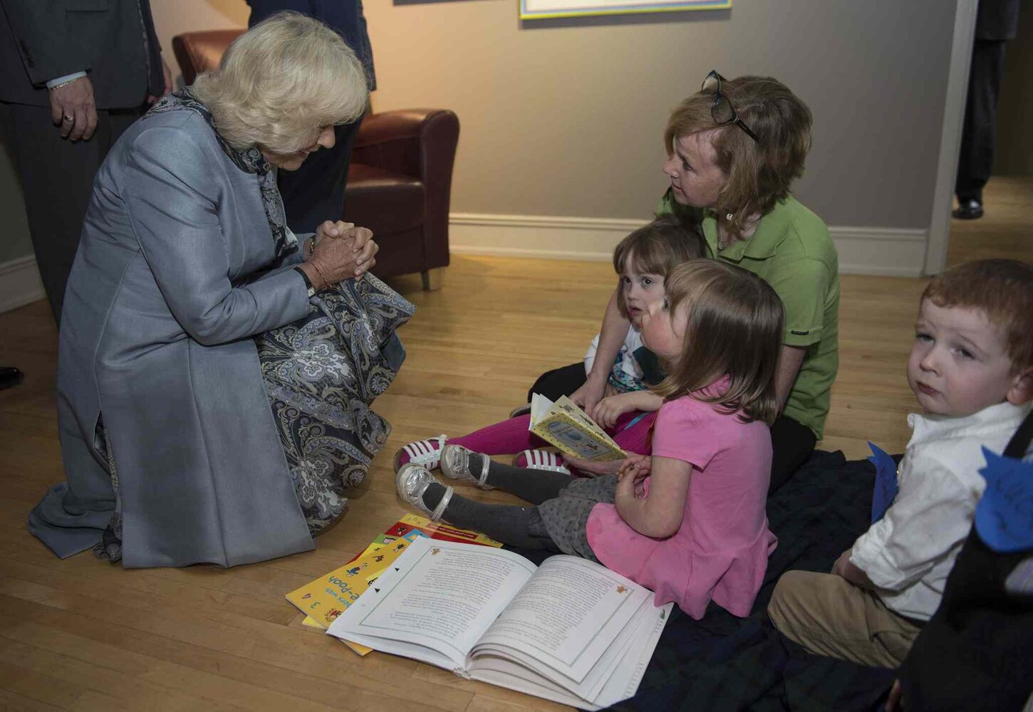 Camilla, the Duchess of Cornwall, meets a group of children at the Pooh Gallery. (Paul Chiasson / The Canadian Press)