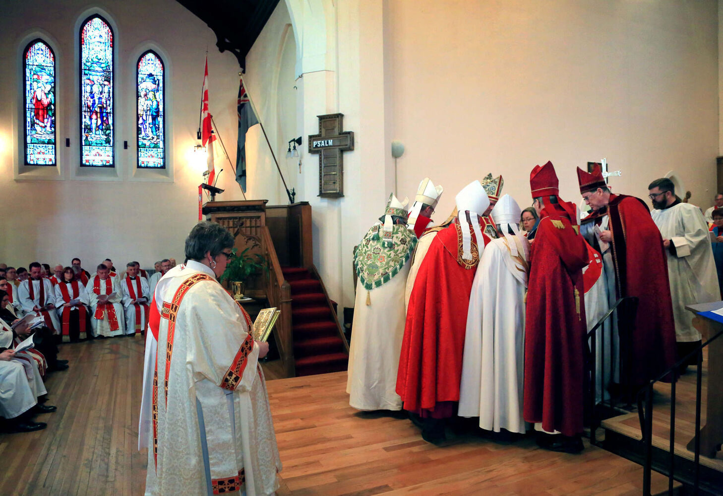 Bishops crowd around the Rt. Rev. William Grant Cliff during a consecration service to promote him to the rank of bishop, Tuesday afternoon at St. Matthew's Cathedral.   (Colin Corneau)