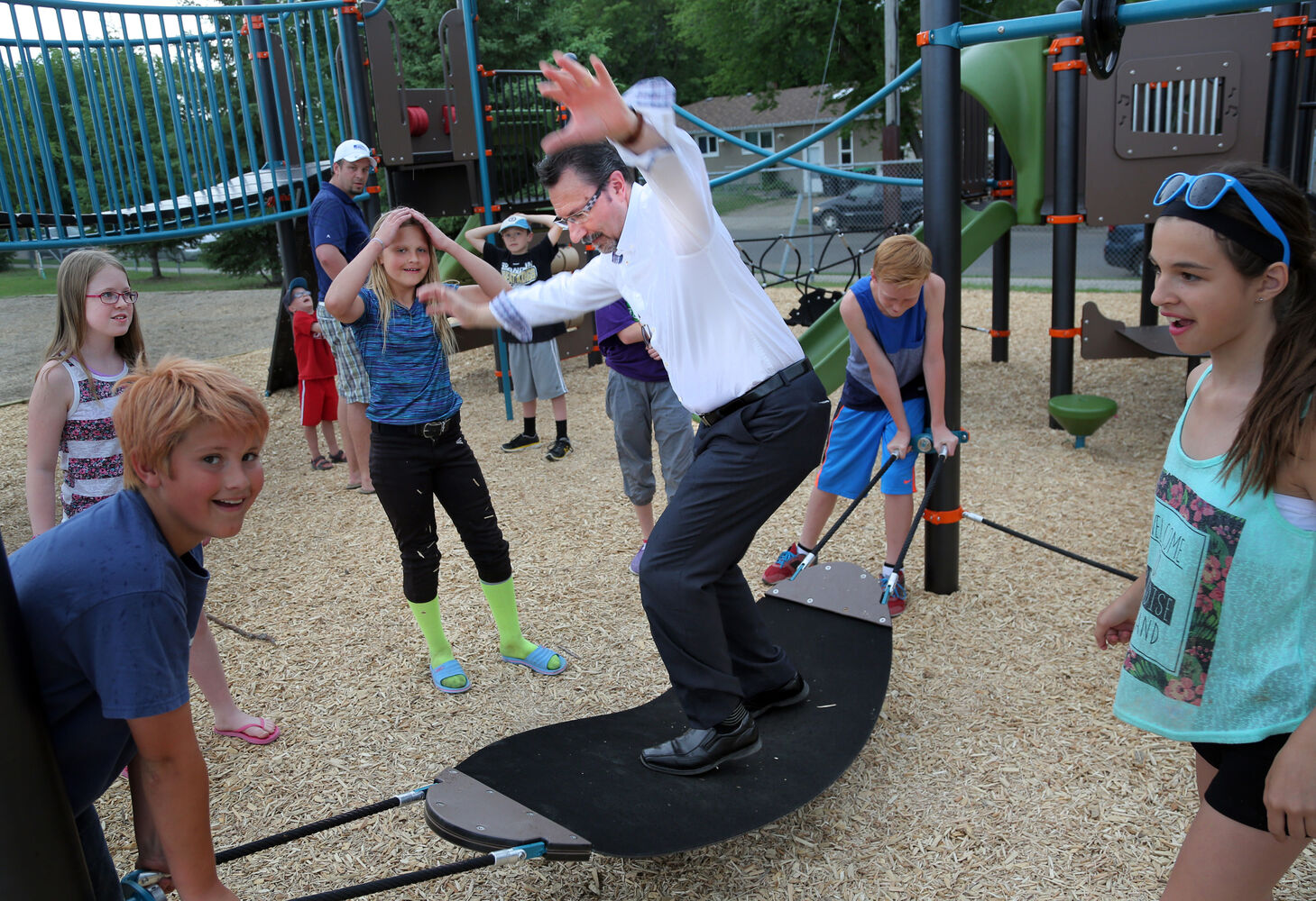 Mayor Rick Chrest tries his hand at the new playground structure at Valleyview School in June. The school opened the structure after fundraising by parents contributed $100,000 since 2011. (Colin Corneau/Brandon Sun)