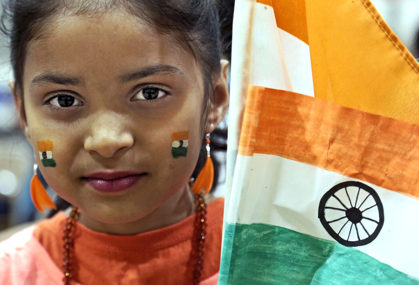 Tiya Patel holds the flag of India at the start of an intercultural show at King George School in March. The fifth annual event featured students of the east end Brandon school showcasing their cultures, including aboriginal, Colombian, Honduran, Indian, Chinese, Ukrainian, Métis, Filipino and Ethiopian. (Colin Corneau/Brandon Sun)