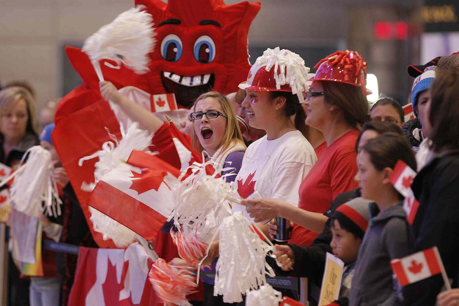 Red and white were the colours of the night as friends, family and fans waited to welcome Team Jones home. ( John Woods / Winnipeg Free Press)