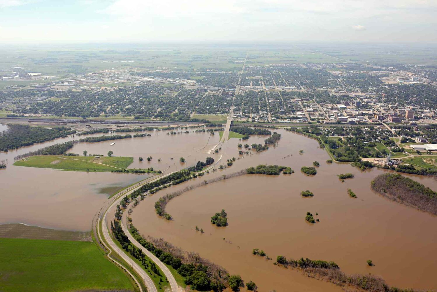 Flood water covers the Assiniboine River Valley in Brandon on Saturday morning, hours ahead of the expected first crest.  (Tim Smith/Brandon Sun)
