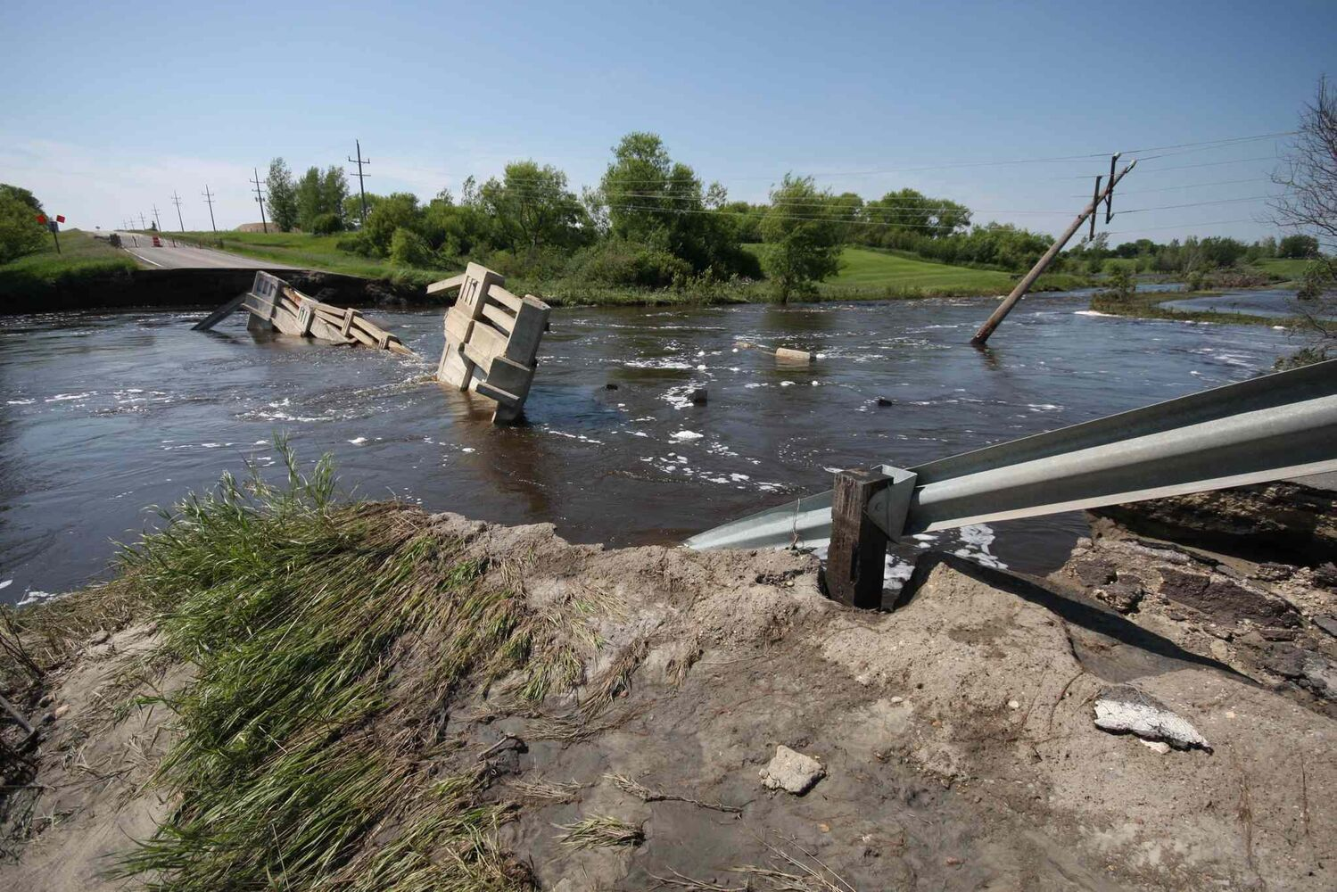 A bridge was completely washed away after this week's flooding on Highway 445 in Melita. (Graeme Bruce / Brandon Sun)