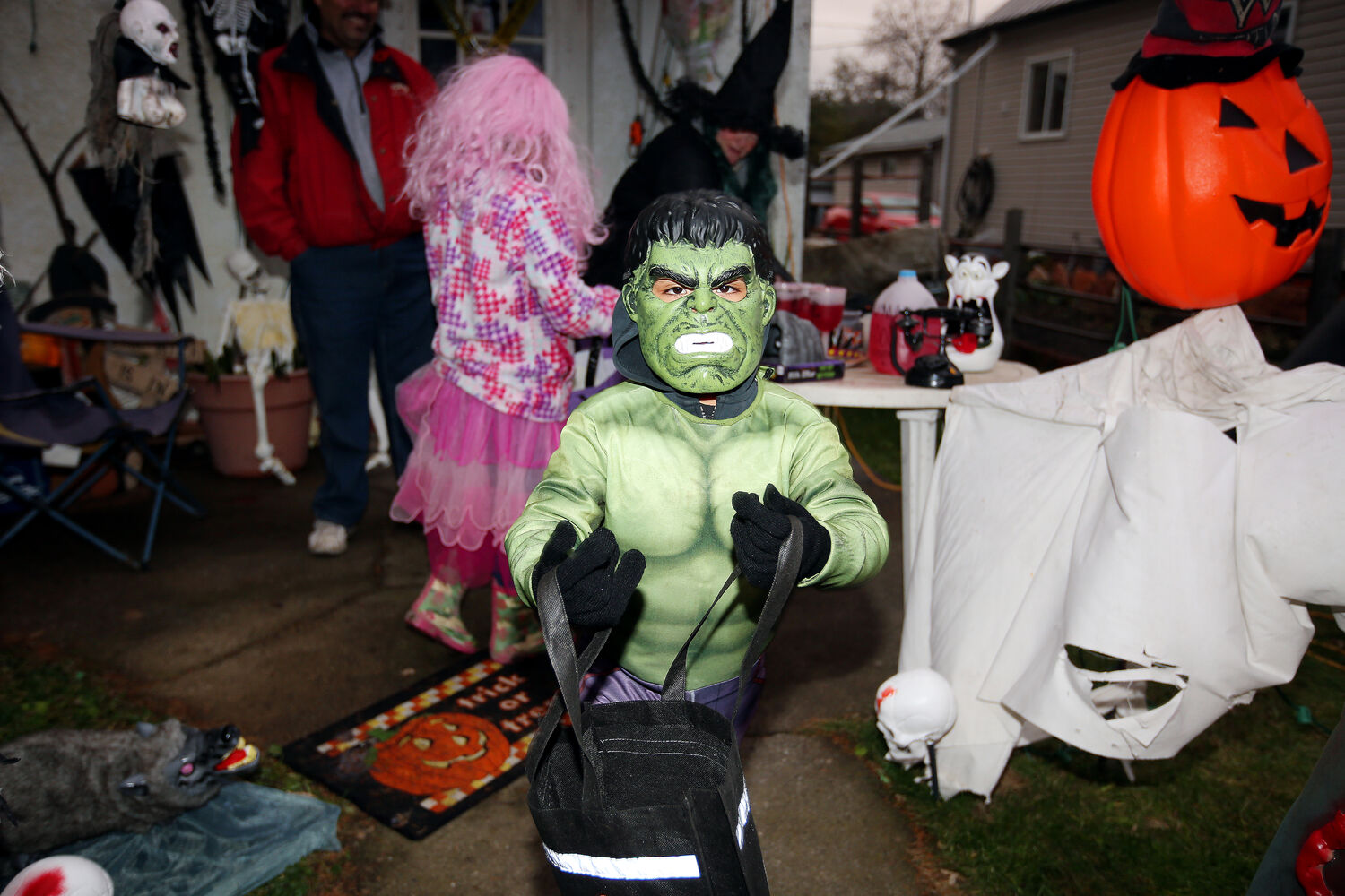 A trick-or-treater heads off in search of more candy after collecting treats at the Sawchuks' home on Saturday evening. (Tim Smith/Brandon Sun)