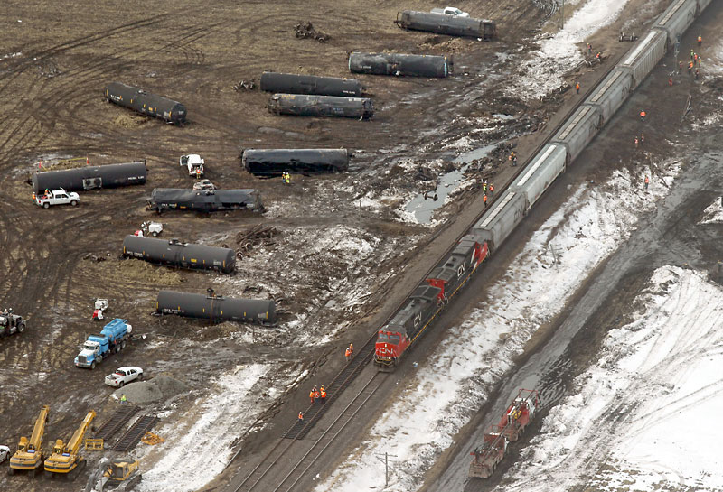 Cleanup continues at the site of a train derailment on the main CN Rail line about 50 kilometres northeast of Brandon on Thursday. Approximately 30,000 litres of bitumen spilled from a rail tanker after 13 cars derailed Wednesday evening. Repairs to the tracks have been made and traffic has reopened. Flight courtesy of the Brandon Flying Centre.