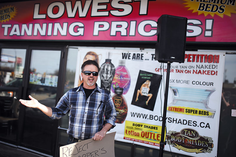 Craig Miller speaks to demonstrators outside Brandon-Souris Conservative MP Larry Maguire's constituency office on Saturday.