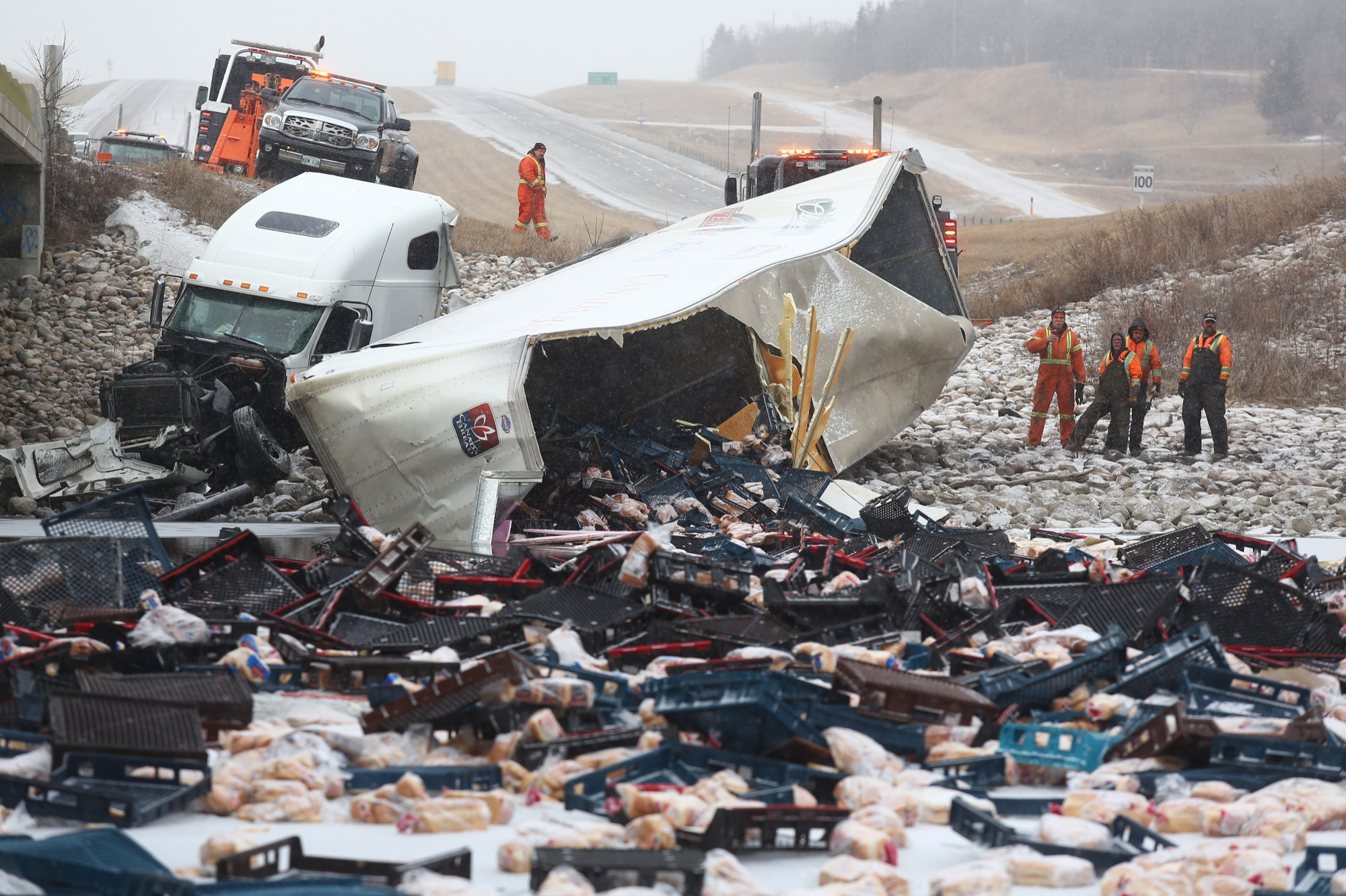 Loaves of bread are spread over an ice-covered Assiniboine River following a semi-truck roll-over on the Trans-Canada Highway in Grand Valley on Friday.