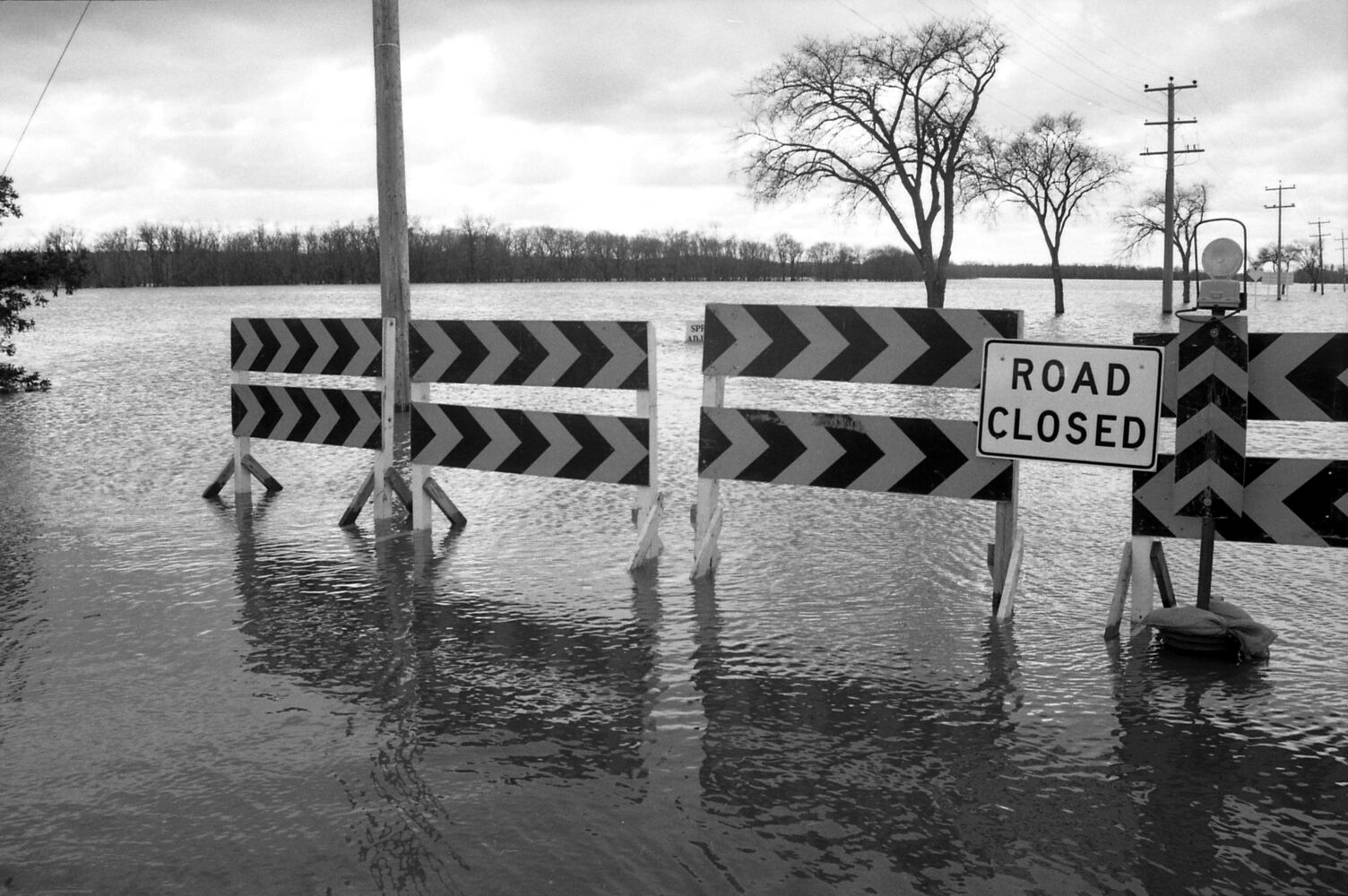 Grand Valley Road is closed. Seen looking southwest from near 18 Street North. (Drik Aberson / Brandon Sun archives, April 25, 1995.)