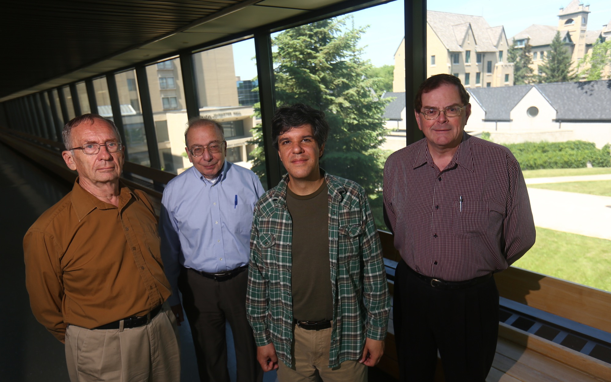American astrophysicist Saul Adelman, second from the left, will be working alongside Brandon University physics and astronomy professors John Rice, left, Tyler Foster and Austin Gulliver, right, in the faculty of science.