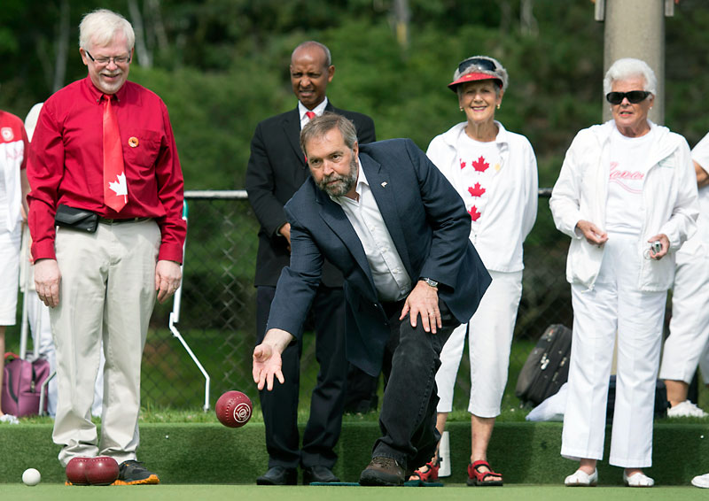Federal New Democratic Party Leader Tom Mulcair, centre, bowls during a Canada Day tournament at the James Gardens Lawn Bowling Club in Toronto on Wednesday. Shaun Cameron writes that by not getting dragged into negative campaigning, Mulcair could put his party in a good position come election day.