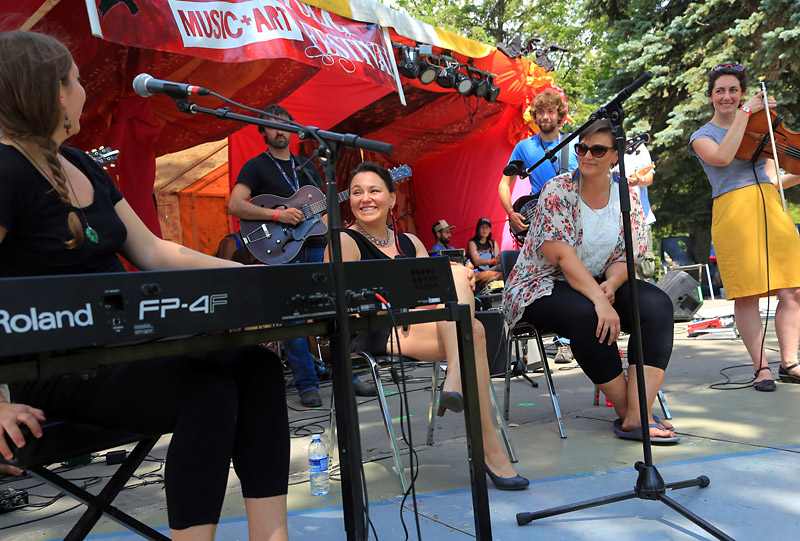 """Ingrid Gatin (left), Tanya Tagaq, Emma Cloney and Rachael Cardiello take the stage during the """"Womens Voices"""" afternoon workshop at the 2015 Brandon Folk Music and Art Festival."""