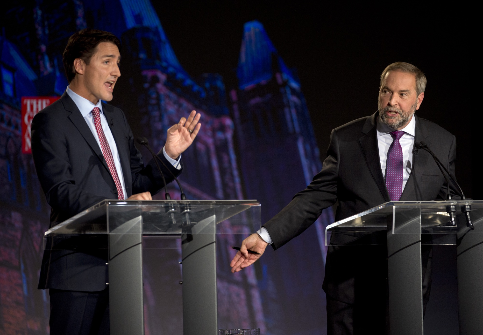 Liberal leader Justin Trudeau, left, debates NDP leader Tom Mulcair during the Globe and Mail leaders' debate in Calgary last week. Both leaders have stated firmly that they would not prop Conservative Leader Stephen Harper if his party wins a minority government in next month's federal election.