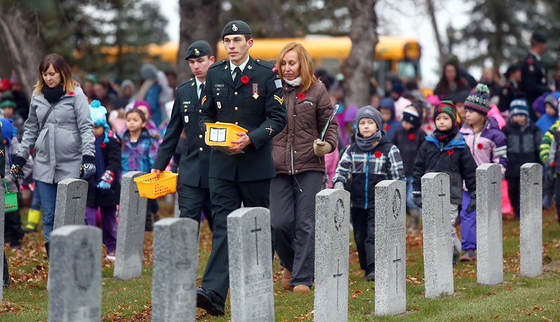 Approximately 700 students from École Harrison, St. Augustine School and Valleyview Centennial School participated in this year's No Stone Left Alone ceremony at the Brandon Cemetery on Thursday. Escorted by members of the 2nd Battalion, Princess Patricia's Canadian Light Infantry, the students placed poppies on each of the military headstones following the act of remembrance ceremony at the cenotaph.
