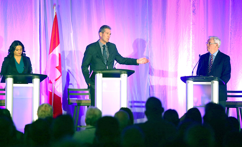 Manitoba Liberal Leader Rana Bokhari, from left, Progressive Conservative Leader Brian Pallister and Premier Greg Selinger face off at the Association of Manitoba Municipalities convention during a debate on Wednesday afternoon.