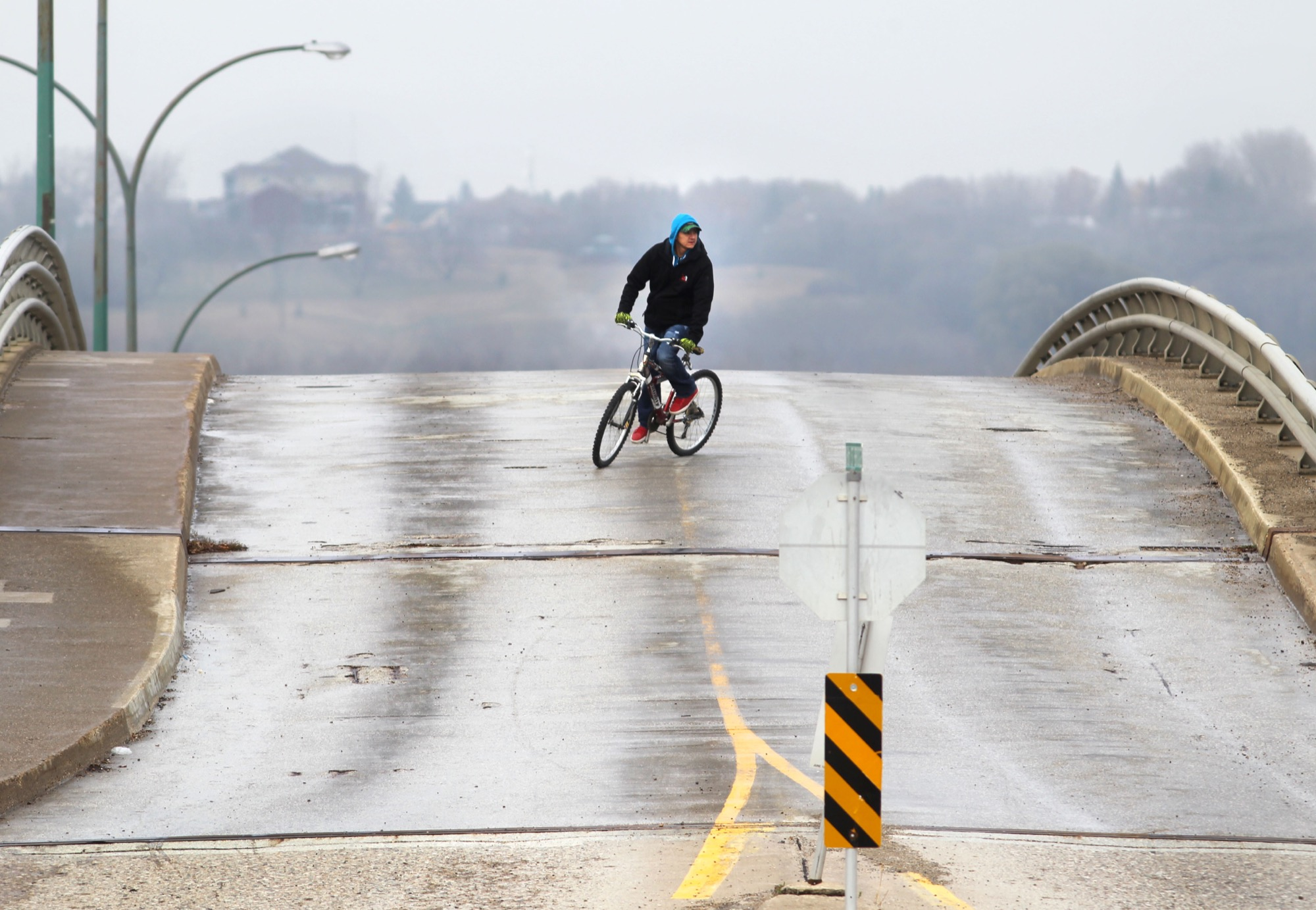 A cyclist wends his way down the Eighth Street bridge, which has been closed to all vehicular traffic earlier this summer.