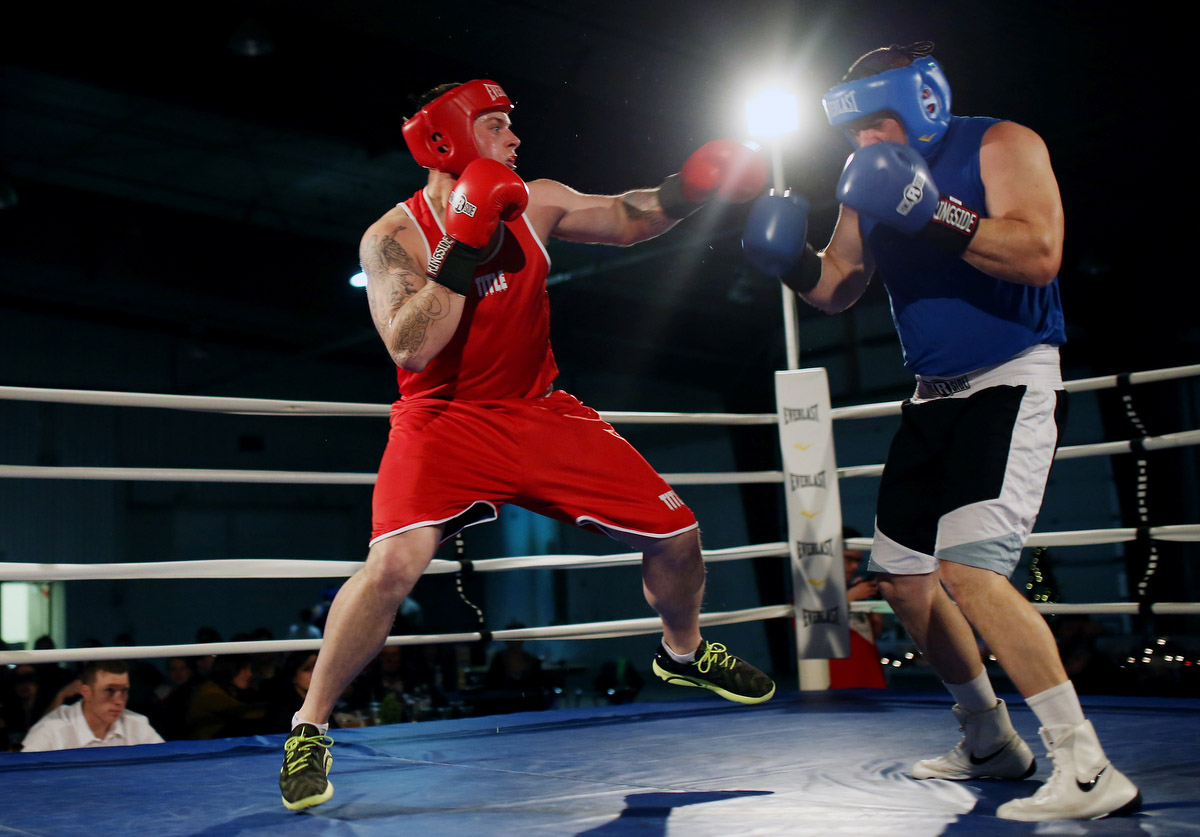 Justin Hunkin and Josh Seeland of the Brandon Boxing Club exchange blows during the Merry Christmas and Seasons Beatings event hosted by the Brandon Boxing Club at the Keystone Centre's Manitoba Room on Saturday evening.